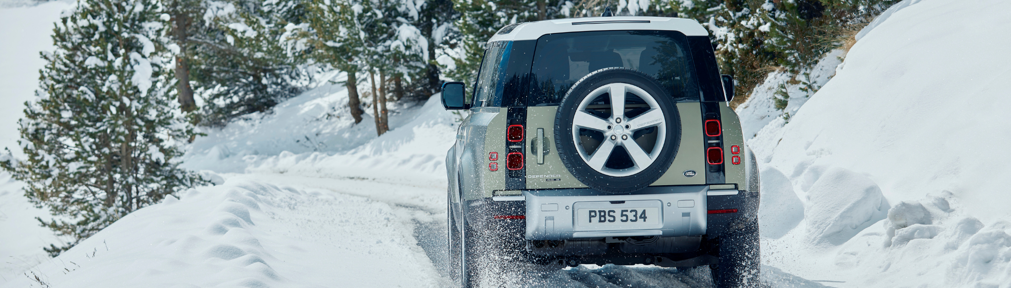 Land Rover Defender Driving In Snow