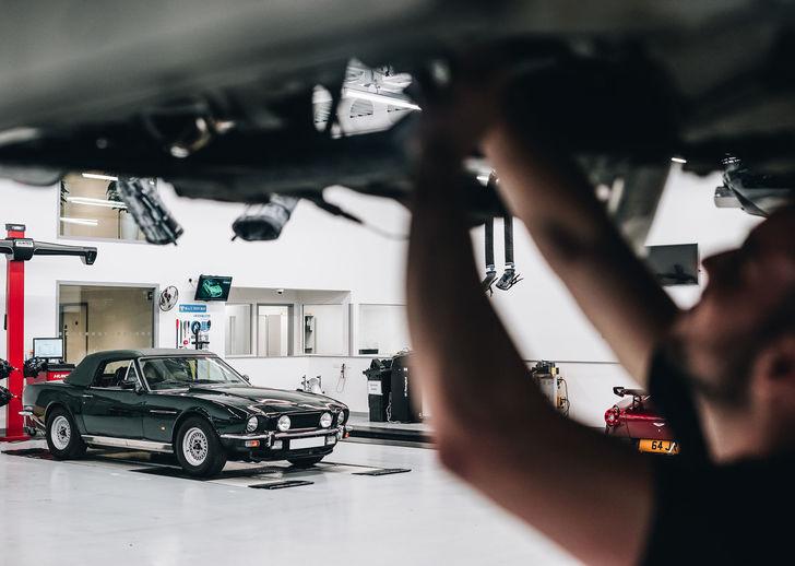 Aston Martin Technician Servicing Aston MArtin