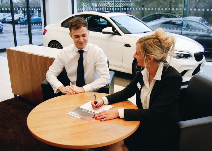 BMW Business Leasing Staff At Desk